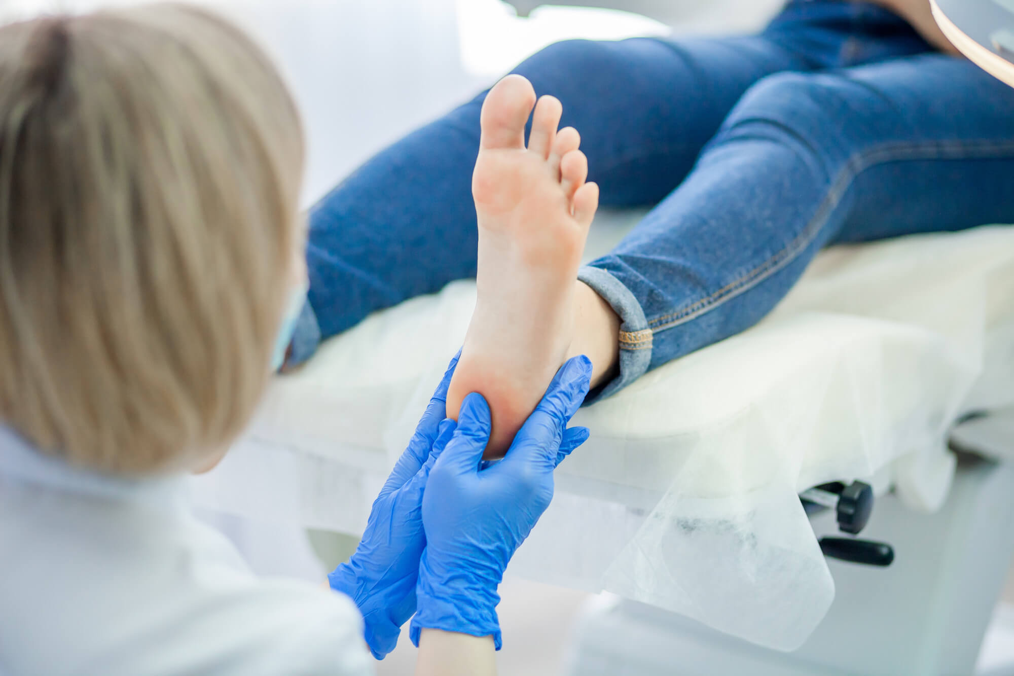 podiatrist treats foot